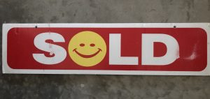 SOLD sign rider with smiley face O