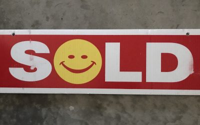 Holding The SOLD Sign