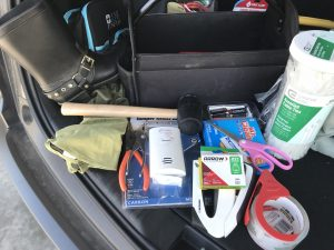 Trunk of a realtors car with all the tools of the trade