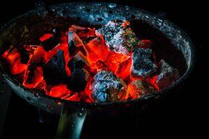red hot coals in a pan