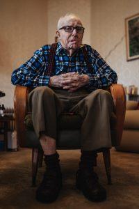 elderly man in a chair