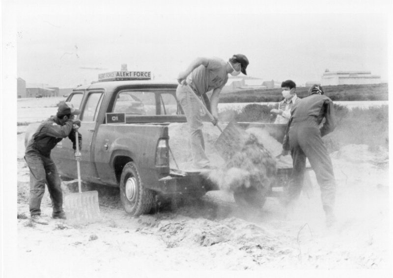 Ash clean up wearing masks Fairchild AF May 18 1980